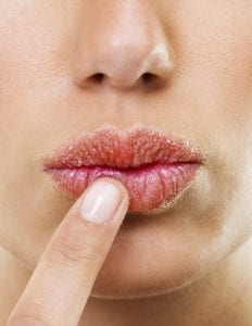 Closeup shot of a woman touching her lips